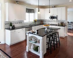 kitchen grey metal kohler faucet 99da white cabinets with dark granite countertops brown wooden countertop gray