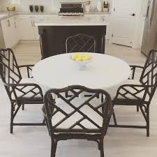 eat in kitchen boasts a crate barrel marble fruit bowl placed atop an ikea docksta dining table paired with four ballard designs macau armchairs placed
