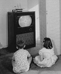 black kids watching tv. children watching television in the 1950s. black kids tv