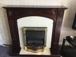 dark wood fire surround with electric fire