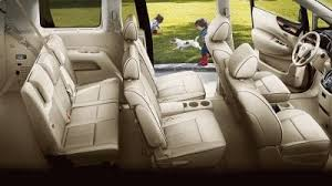 nissan quest platinum shown in beige leather highlighting 3 rows of ious seating