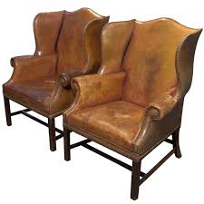 pair of english leather wingback chairs