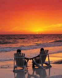 adirondack chairs on beach sunset. Interesting Chairs Adirondack Chairs On Beach Sunset Couple Watching Beautiful Sunset  Via Carolu0027s And Adirondack Chairs On Beach Sunset