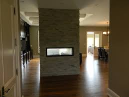 double sided gas fireplace in bungalow entry