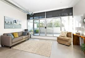 living room with sliding glass door to balcony artwork from photographer portfolio photo by