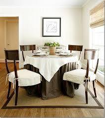 ivory chocolate brown dining room design with klismos dining chairs round dining table with gl top and rich brown linen tablecloth