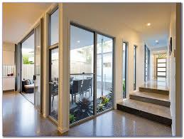 replace glass in window cost