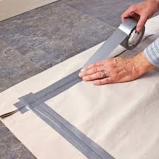 creative ideas turn a drop cloth into a custom colored rug with paint