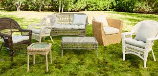 assorted wicker patio furniture with cushions
