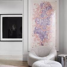 The wall next to my tall 'naked' wall has a fireplace, with windows on both sides that leave only 30 inches from bottom of window to floor. 20 Chic Living Room Wall Decor Ideas