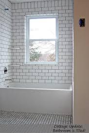 Bathroom ~ white subway tile w dark grout +