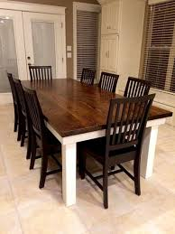 james james solid red oak 8 l x 45 w farmhouse table features a jointed dark walnut stained top with an ivory painted base pictured with jane chairs