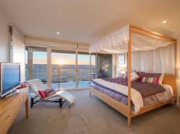 bedroom suite of adelaide luxury beach house at sunset