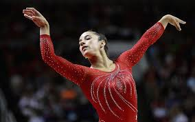 aly raisman peting in the floor exercise at the 2016 u s women s gymnastics olympic trials in