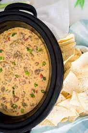 Add ground beef, tomatoes & more for this velveeta shells & cheese cheeseburger mac. Crock Pot Queso With Beef Sausage