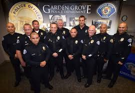officer christopher doveas garden grove pd s newest officer center stands with other ggpd personnel including chief todd elgin to his right