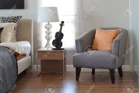 Modern Bedroom Chair Modern Bedroom Interior With Orange Pillow On Grey Chair And