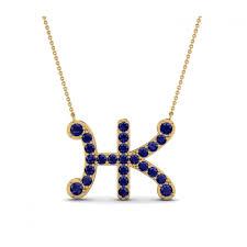 designer initial diamond pendant