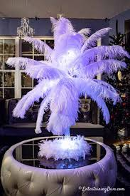 feather centerpiece with pink glitter lights