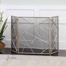 decorative iron fireplace screen features a lightly antiqued silver leaf finish center panel is