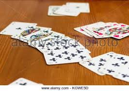 Wooden Sequence Board Game playing in rummy card game on wooden table group of cards Stock 70