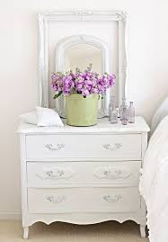 vintage styled dresser with gentle pop of color and empty frame around the mirror to give antique dresser framed leaning mirror shabby chic