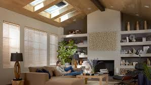 man sitting in living room enjoying natural light from velux skylights