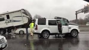 13News Now - WVEC - Car drives under truck pulling camper in ...