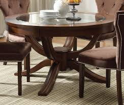 glass top pedestal dining table acme kingston glass top round pedestal dining table in brown furniture