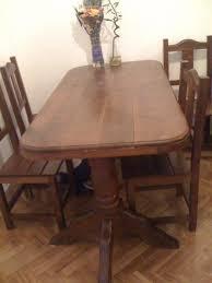 mesa y sillas de algarrobo. Cargando zoom.
