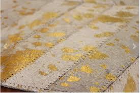 metallic gold herringbone cow hide rug anima and amare metallic gold bathroom rugs