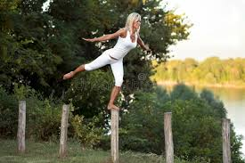 white fence post. Download Woman Balancing On Fence Post Stock Photo - Image Of White, Bare: 33121540 White W