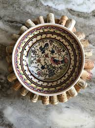 top view of painted ceramic bowl on top of diy upcycled wine cork trivet wreath