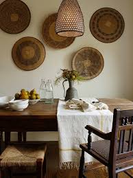 awesome dining space with honeycomb lantern decorative wall baskets farmhouse dining table wood bench and seagrass stools jute interior design