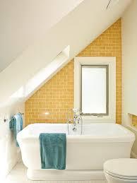 coastal subway tile and yellow tile mosaic tile floor and white floor freestanding bathtub photo in
