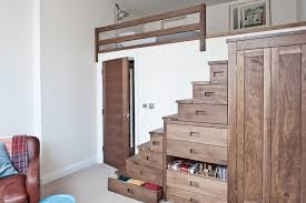 Cool space saving staircase designs ideas Shelterness This Storage Staircase Features An Amazing Amount Of Drawers And Even Builtin Wardrobe Digsdigs 35 Really Cool Space Saving Staircase Designs Digsdigs