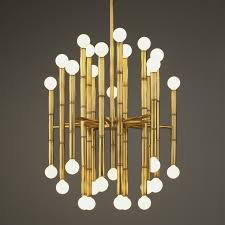 view in gallery brass chandelier from jonathan adler
