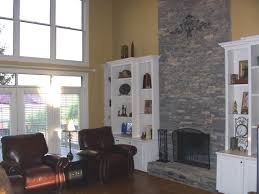 bookshelves like these with cabinets under them would be perfect for shelves nightstands stone fireplace