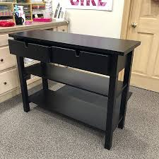 sliding drawers and shelves of ikea norden wooden sideboard