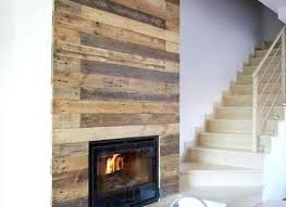pallet wall surrounding faux fireplace fake