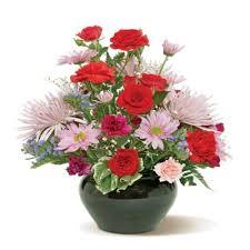 pretty palette flowers arrangement in a vase