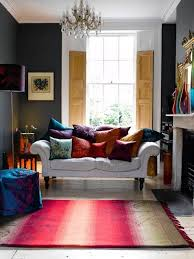 room jewel tone rug bringing all the color into the beige and gray living room through acc