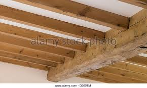 Beautiful traditional wooden beams in a newly converted barn in rural  England. - Stock Image