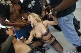 Shaved Blonde Black Cherie DeVille Enjoying Bukkake Image.
