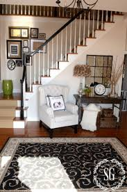 A NEW CHAIR AND MORE DECOR. Stairwell WallFoyer ...