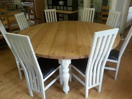 8 person dining table. Wooden 8 Person Round Dining Table With White Bases And Chairs I