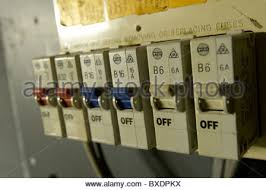 domestic home electrics main fuse box on off switch uk stock old electrical installation fuse box stock photo