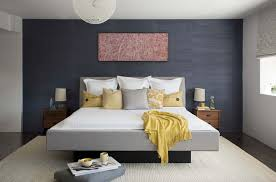 Master bedroom gray color ideas Accent Wall This Master Bedroom Features Woven Warm Wall Treatment The Wallpaper Is Phillip Jeffries Ltd 5274 Navy The White Waffle Blanket Was Sourced From One Kindesign 25 Absolutely Stunning Master Bedroom Color Scheme Ideas