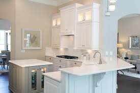 kitchen with lg viatera minuet white quartz countertops and white cabinets