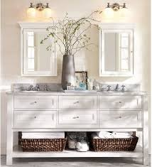 double vanity with two mirrors. most that had double sinks and side sconces where 72 inch vanities or wider. maybe do something like the one below with lighting above 2 mirrors centered vanity two houzz